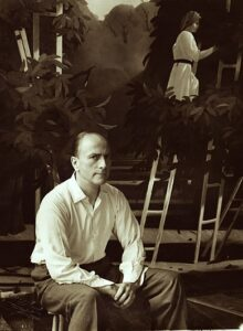 Pyke Koch in zijn atelier (1955) met achter hem zijn schilderij De Oogst uit 1953